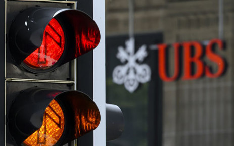A sign of the Swiss banking giant UBS is seen behind traffic lights on June 7, 2013 in Lausanne. Picture: AFP.