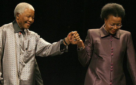 FILE: Former president Nelson Mandela is helped by his wife Graca Machel. Picture: Werner Beukes/SAPA