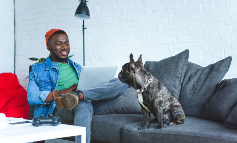 Young man working from home with his dog 123rfbusiness 123rflifestyle 123rf