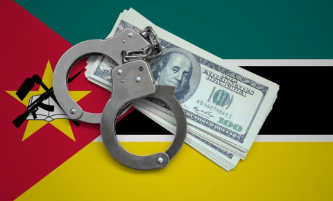 mozambique-flag-with-handcuffs-and-dollar-notesjpg