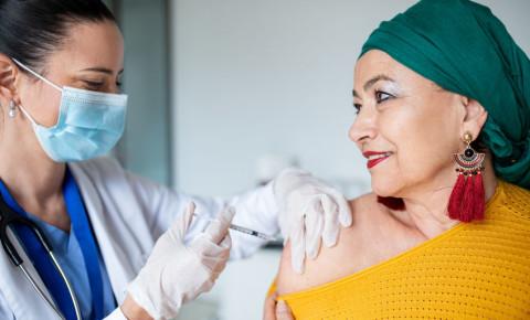 Older senior female woman vaccinated vaccine vaccination happy Covid-19
