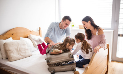 young-family-travel-suitcase-parents-trip-getaway-guesthouse-accommodation-123rf