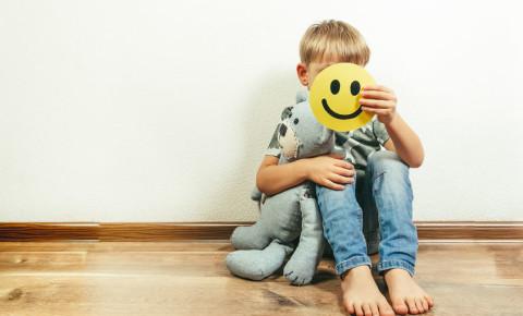 Depressed boy child holding smile smiley pretending depression depressed 123rf