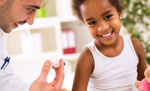 Happy child getting vaccine vaccinated Covid-19 flu influenza 123rf