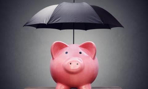 safe-investment-piggy-bank-with-umbrellajpg