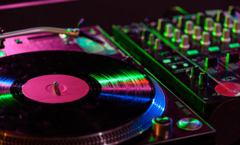 Mixing desk with vinyl in a night club