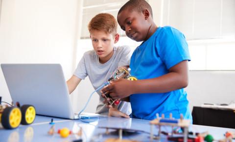 Boys students programming coding robot computer robotics 123rf