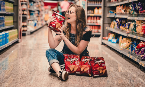 Woman Holding Bag Of Chips doritos pexels