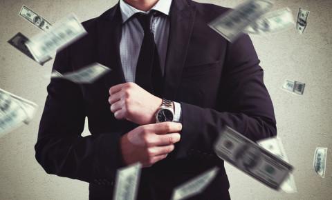 Rich wealthy businessman in suit watch dollars cash money 123rfBusiness 123rf