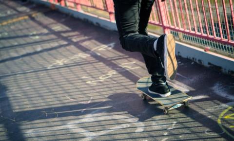 young-skateboarder-on-pedestrian-walkwayjpg