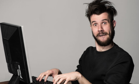 Crazy funny man working from home on desktop computer 123rf 123rfbusiness