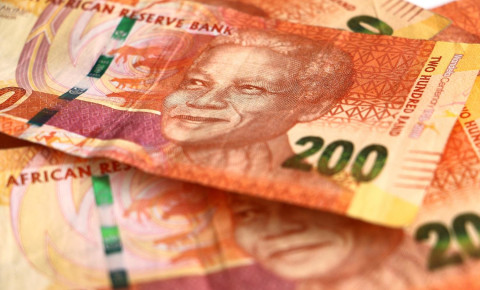 A pile of two hundred rand notes, South African currency money