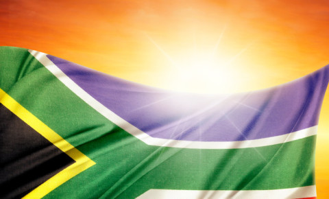 South African flag in front of bright sky hope 123rf