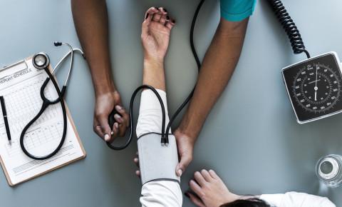doctor-checking-blood-pressure-reusablejpeg