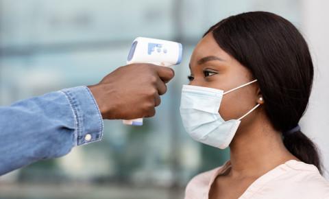 Covid-19-safety-protocols-temperature-check-digital-thermometer-mask-black-woman