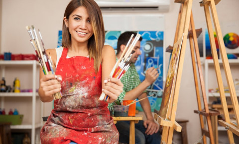 young-woman-with-paint-brushes-hobbiesjpg