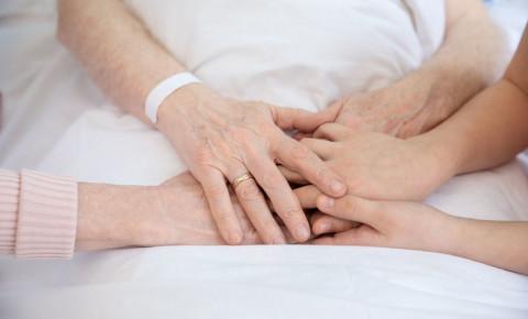 hospital patient illness holding hands comfort terminal illness sickness 123rf