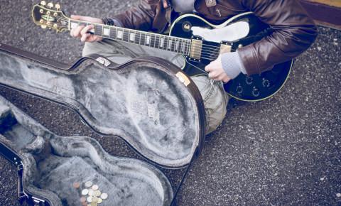Struggling poor artist musician guitarist busker busking 123rf
