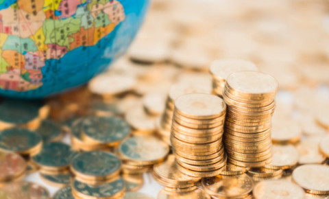 gold-coins-with-africa-on-globe-economyjpg
