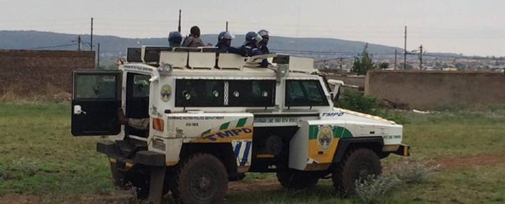 Tshwane police keep an eye on residents who are occupying land illegally. Picture: Barry Bateman/EWN