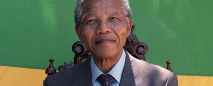 Anti-apartheid leader and African National Congress (ANC) member Nelson Mandela smiles as he poses during a photo session after his first press conference since his release from jail on 12 February 1990 in Cape Town. Picture: AFP.