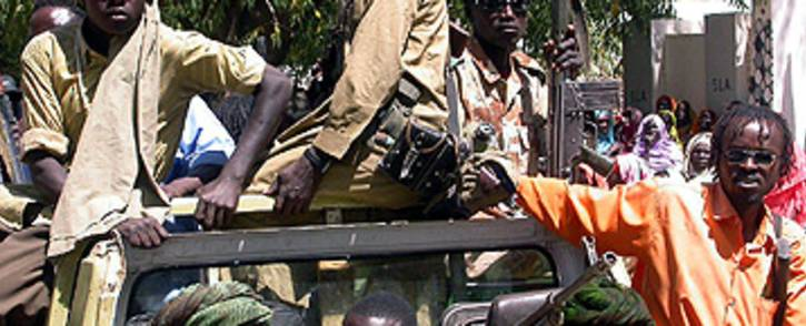 FILE: Sudan armed men from the Sudan Liberation Movement Army (SLMA) in Gereida town, south Darfur, Sudan, 24 February 2006. Despite a May peace deal, the UN says violence and displacement have increased in the region. Picture: Derk Segaar/IRIN