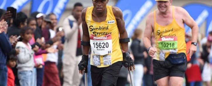 Amputee runner Xolani Luvuno taking part in the 2018 Comrades Marathon. Picture: @MMStadium/Twitter.