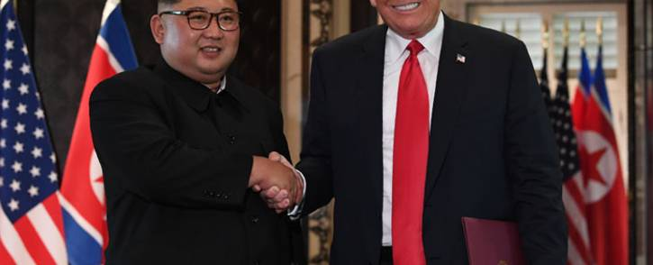 FILE: North Korea's Kim Jong Un shakes hands with US President Donald Trump during their summit meeting in Singapore on 12 June 2018. Picture: AFP