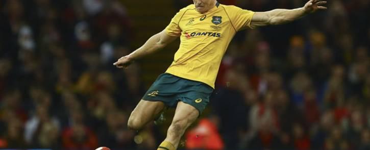 Australia's Reece Hodge kicks at goal. Picture: AFP