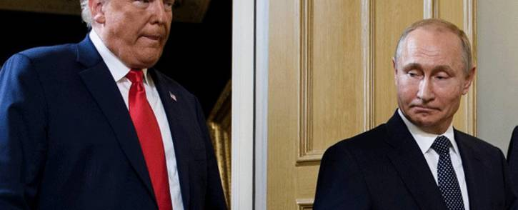 In this file photo taken on July 16, 2018 US President Donald Trump (L) and Russian President Vladimir Putin arrive for a meeting in Helsinki. Picture: AFP.