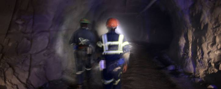 Miners walk down a mine shaft. Picture: AFP