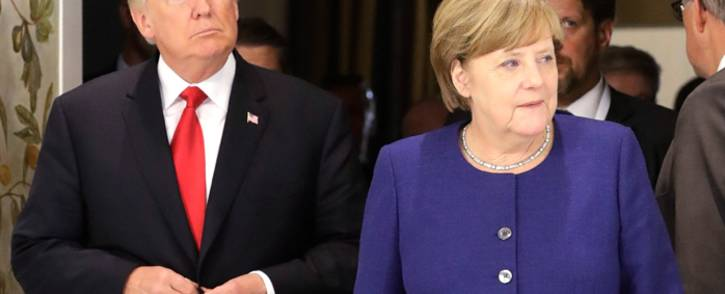 FILE: US President Donald Trump and German Chancellor Angela Merkel arrive for a bilateral meeting on the eve of the G20 summit in Hamburg, northern Germany, on 6 July 2017. Picture: AFP