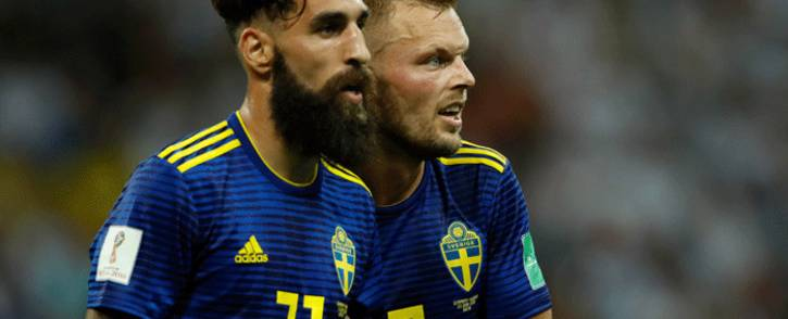 FILE: Sweden's midfielder Jimmy Durmaz (L) and Sweden's midfielder Sebastian Larsson (R) react at the end of the Russia 2018 World Cup Group F football match between Germany and Sweden at the Fisht Stadium in Sochi on 23 June 2018. Picture: AFP