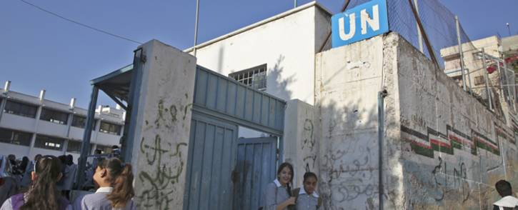 Children return to school at an establishment run by United Nations Agency for Palestinian Refugees (UNRWA) in Balata refugee camp, east of Nablus in the occupied West Bank on 29 August 2018, on the first day of classes after the summer holidays. US President Donald Trump cut of more than $200 million in aid for Gaza and the West Bank this month after earlier freezing of $300 million in annual funding for the UNRWA. Picture: AFP