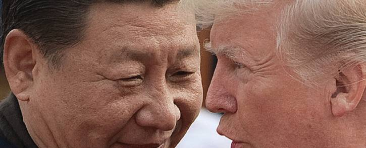 FILE: China's President Xi Jinping (L) and US President Donald Trump attend a welcome ceremony at the Great Hall of the People in Beijing on 9 November 2017. Picture: AFP