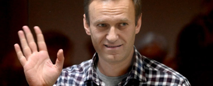 In this file photo Russian opposition leader Alexei Navalny stands inside a glass cell during a court hearing at the Babushkinsky district court in Moscow on 20 February 2021. Picture: AFP