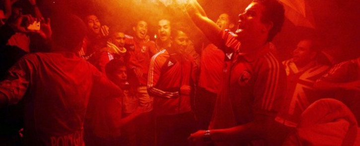 Al Ahly fans celebrate in Cairo after defeating Orlando Pirates 2-0 in the second leg of the CAF champions league final on November 10 2013. Picture: AFP.