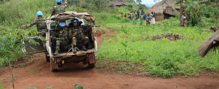 This undated file photo shows peacekeepers serving with the United Nations Stabilization Mission in the Democratic Republic of the Congo (MONUSCO) conduct a patrol in the village of Fataki, Ituri Province, offering protection to inhabitants. Picture: United Nations Photo