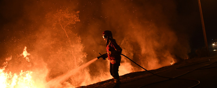A firefighter tries to extinguish a fire in Cabanoes near Louzan as wildfires continue to rage in Portugal on October 16, 2017. Picture: AFP.