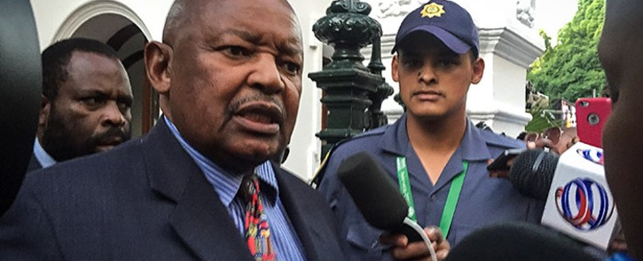Cope leader Mosiuoa Lakota talks to the media outside parliament after his party walked out of the 2016 State of the Nation address. Picture: Aletta Harrison/EWN.