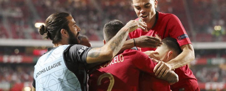 Portugal team members celebrate following their victory over Italy in their UEFA Nations Cup match in Lisbon on 10 September 2018. Picture: @selecaoportugal/Twitter