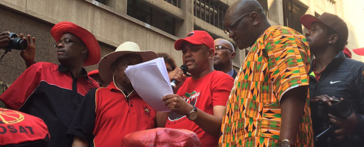 Gauteng Premier David Makhura accepts a memorandum from Cosatu officials during an anti-state capture march in Johannesburg on 27 September 2017. Picture: Masa Kekana/EWN.