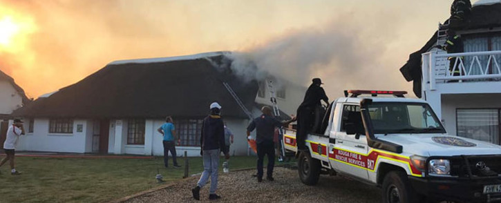 Firefighting efforts to extinguish a fire in St Francis Bay on 22 August 2019. Picture: Kouga Municipality Facebook page