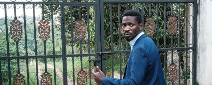 Presidential candidate Robert Kyagulanyi, also known as Bobi Wine, explains to media how uniformed personnel entered through a gate of his home in Magere, Uganda, on 15 January 2021. Picture: Yasuyoshi Chiba/AFP