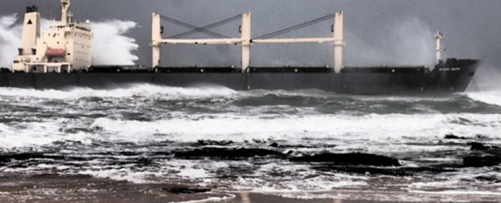 The Kiani Satu bulk carrier ran aground in the Southern Cape on Thursday 8 August between Buffels Bay and Sedgefield after it ran into difficulty in rough seas. Credit: Garden Route Media