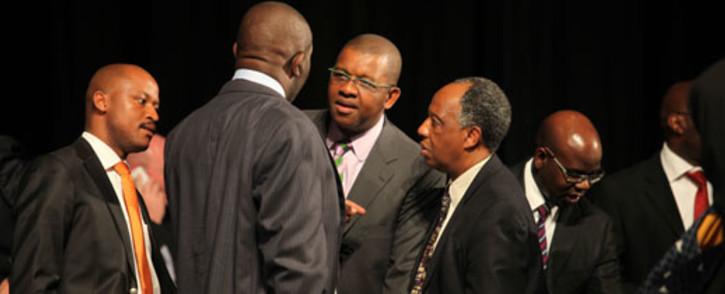 Dali Mpofu and Dumisa Ntsebeza chat during a break at the Farlam Commission of Inquiry on 3 Oct 2012. Picture: Taurai Maduna/EWN.