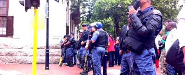 FILE: Heavily armed police block Wale Street during protests in Cape Town on 30 October 2013. Picture: Graeme Raubenheimer/EWN.
