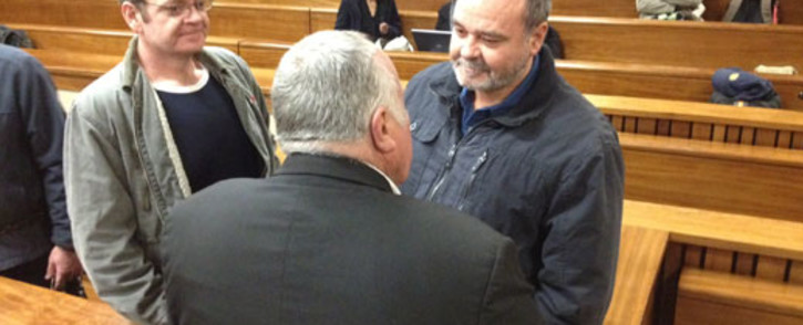 Boeremag accused Andre du Toit (left) and his brother accused Mike du Toit speak to their lawyer in court. Picture: Barry Bateman/EWN.