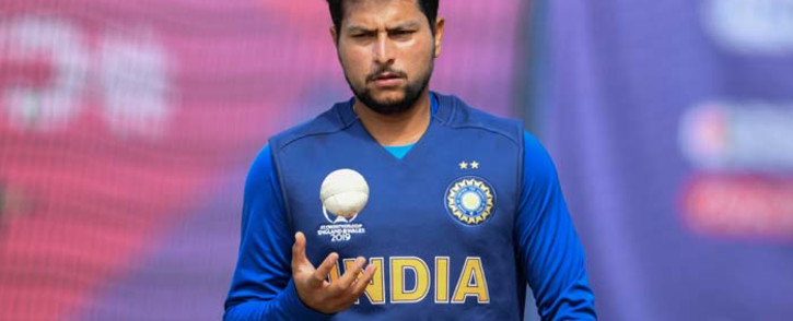 FILE: India's Kuldeep Yadav prepares to bowl in the nets as he takes part in a training session at Old Trafford in Manchester, north-west England on 8 July 2019, ahead of their 2019 Cricket World Cup semi-final match against New Zealand. Picture: AFP
