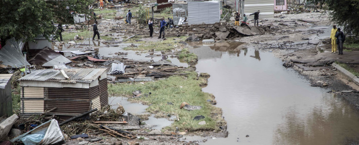 Residents of an informal settlement in Tshwane return to their homes after the flooding. Picture: Abigail Javier/EWN